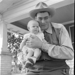 Al Tomaini and Baby on Porch from Life Magazine Article
